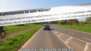 A car driving down a road with the subtitle Suddenly. Headache in the car